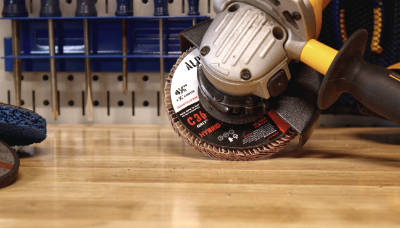 BHA Empire Abrasives - 36 Grit high density ceramic flap disc on angle grinder in garage